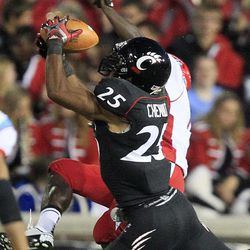 Cincinnati defensive back Arryn Chenault (25) intercepts a pass intended for Delaware State wide receiver Travis Tarpley during the first half of an NCAA college football game, Saturday, Sept. 15, 2012, in Cincinnati.