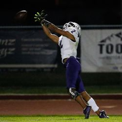Tooele's Gabe Medina (2) attempts a pass during a high school football game against Tooeleat Stansbury High School in Stansbury Park on Friday, Sept. 17, 2021.