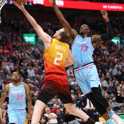 Utah Jazz guard Joe Ingles (2) drives to the hoop with Miami Heat forward Bam Adebayo (13) defending as the Utah Jazz and the Miami Heat play in an NBA basketball game at Vivint Smart Home Arena in Salt Lake City on Wednesday, Feb. 12, 2020.