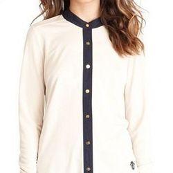 "<a href=""http://www.toryburch.com/REENA-BLOUSE/11122113,default,pd.html?dwvar_11122113_color=163&start=3&cgid=sale"">Reena blouse</a>, $125 (was $225)"