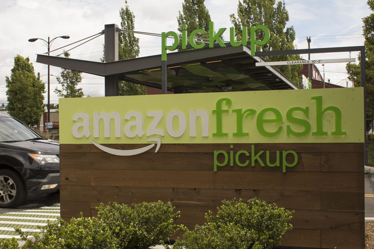 A sign for Amazon Fresh pickup