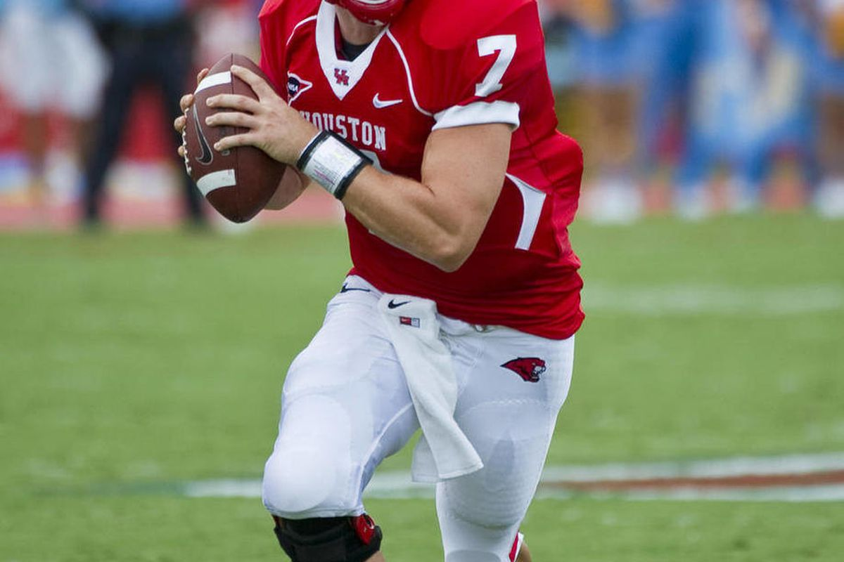 In this Sept. 3, 2011, photo, Houston quarterback Case Keenum looks for a receiver during an NCAA college football game against UCLA in Houston. Keenum says he plans to sign with the Houston Texans. Keenum said Monday, April 30, 2012, the Texans have told