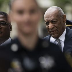 Bill Cosby, right, accompanied by Andrew Wyatt arrives for his sexual assault trial at the Montgomery County Courthouse in Norristown, Pa., Saturday, June 17, 2017.
