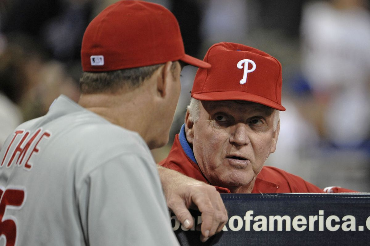 Dr. Manhattan and Phils' skipper Charlie Manuel talk strategy.  (Photo by Denis Poroy/Getty Images)