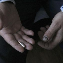 In this photo taken Tuesday, April 10, 2012, a Syrian refugee shows a bullet allegedly fired from the Syrian side of the border, at a camp just few hundreds meters from the border, in Kilis, Turkey.  Turkey's prime minister accused Syria of infringing its border and said Tuesday that his country is considering what steps to take in response.