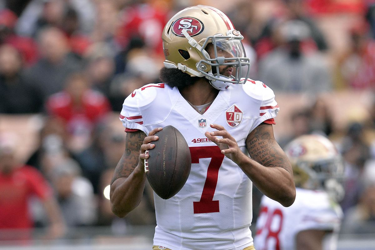 San Francisco 49ers quarterback Colin Kaepernick throws against the Los Angeles Rams during the first half at Los Angeles Memorial Coliseum.