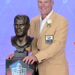 Brett Favre poses with his Hall of Fame bust