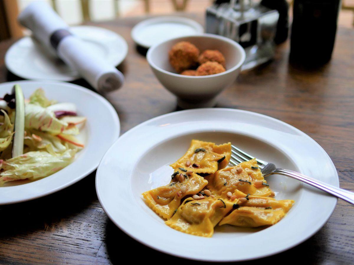 Ravioli, arancini, and salad at Cafe Murano