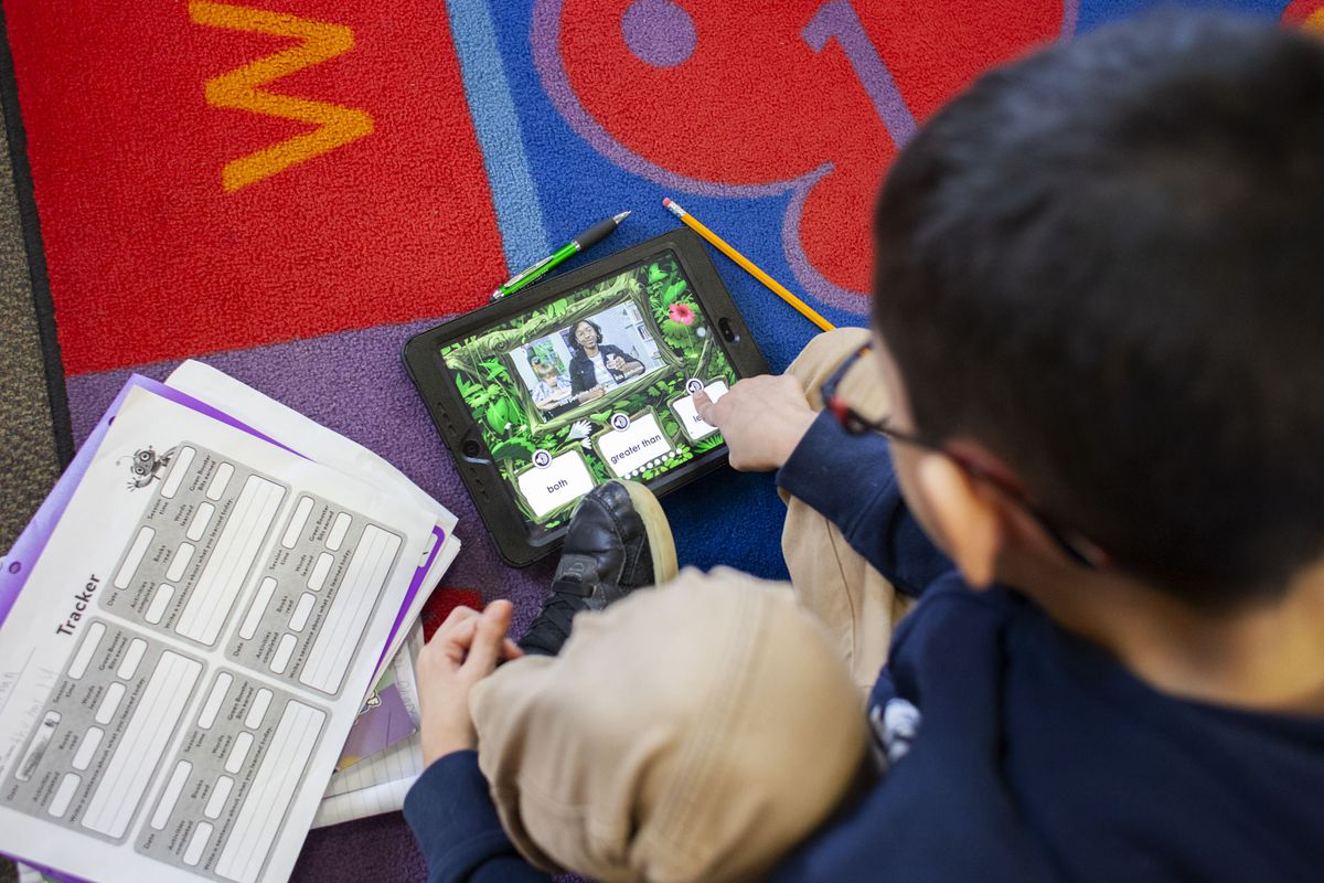 Jonathan C. selects an answer to a question on a digital learning program during class at CICS West Belden. The Chicago charter school employs the personalized learning method for its K-8 students. The school is part of the Chicago International Charter School network, and is managed by Distinctive Schools. Photo by Stacey Rupolo/Chalkbeat NOTE: Last names not given by school