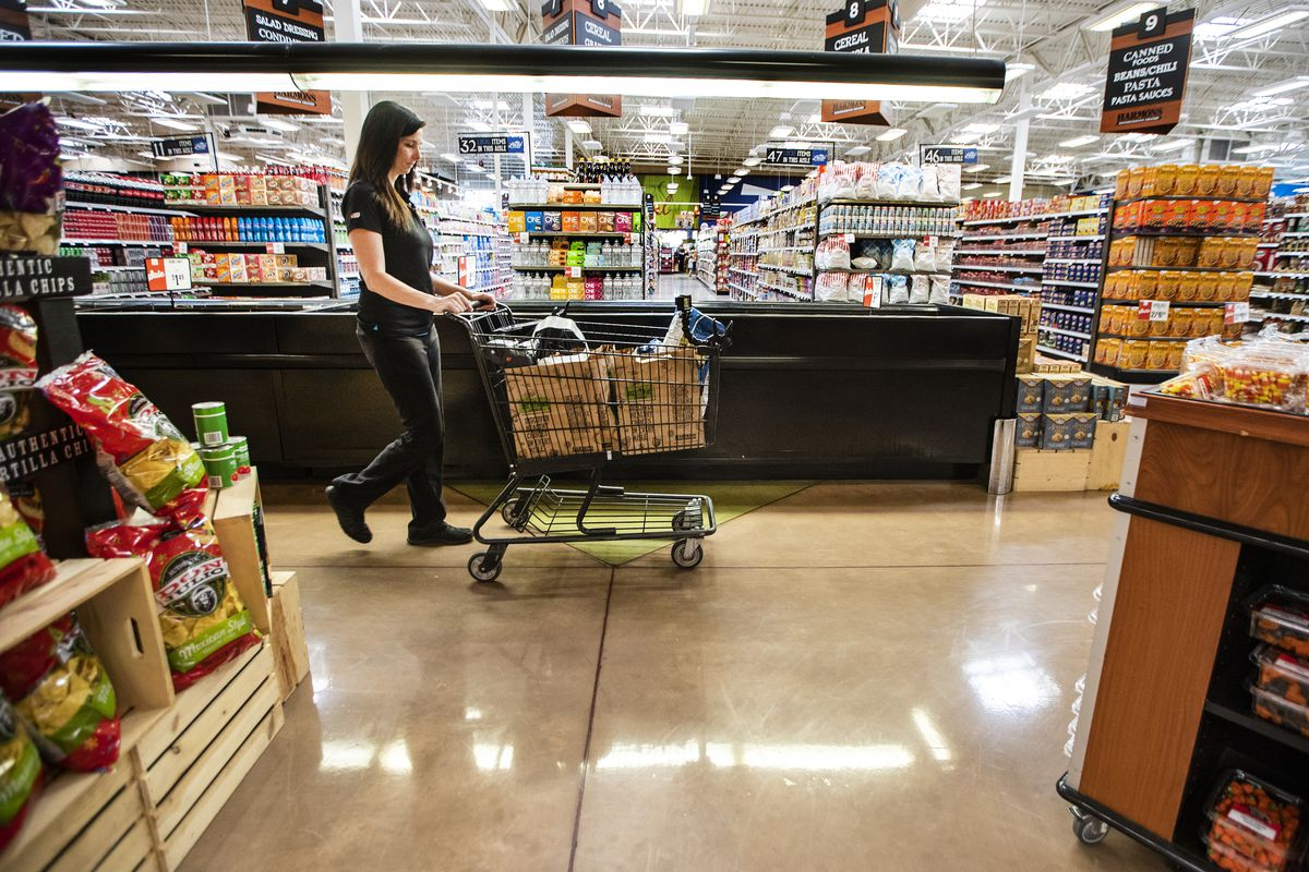 E-shop specialist Jessica Hansen, picks a food order at the Harmons Grocery at Bangerter Crossing in Draper on Tuesday, Sept. 18, 2018.