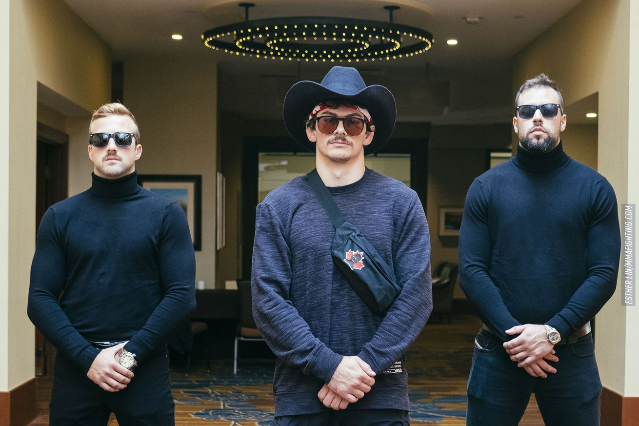 """Olivier Aubin-Mercier flanked by his two """"bodyguards"""" at a media event Thursday to promote UFC on FOX 30 in Calgary, Alberta"""