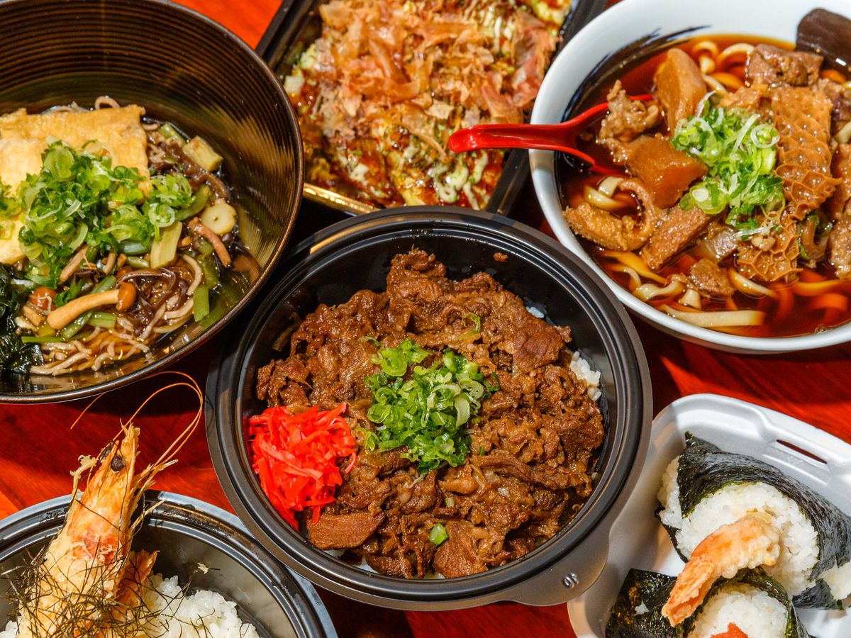 Four bowls of Japanese food seen from above.
