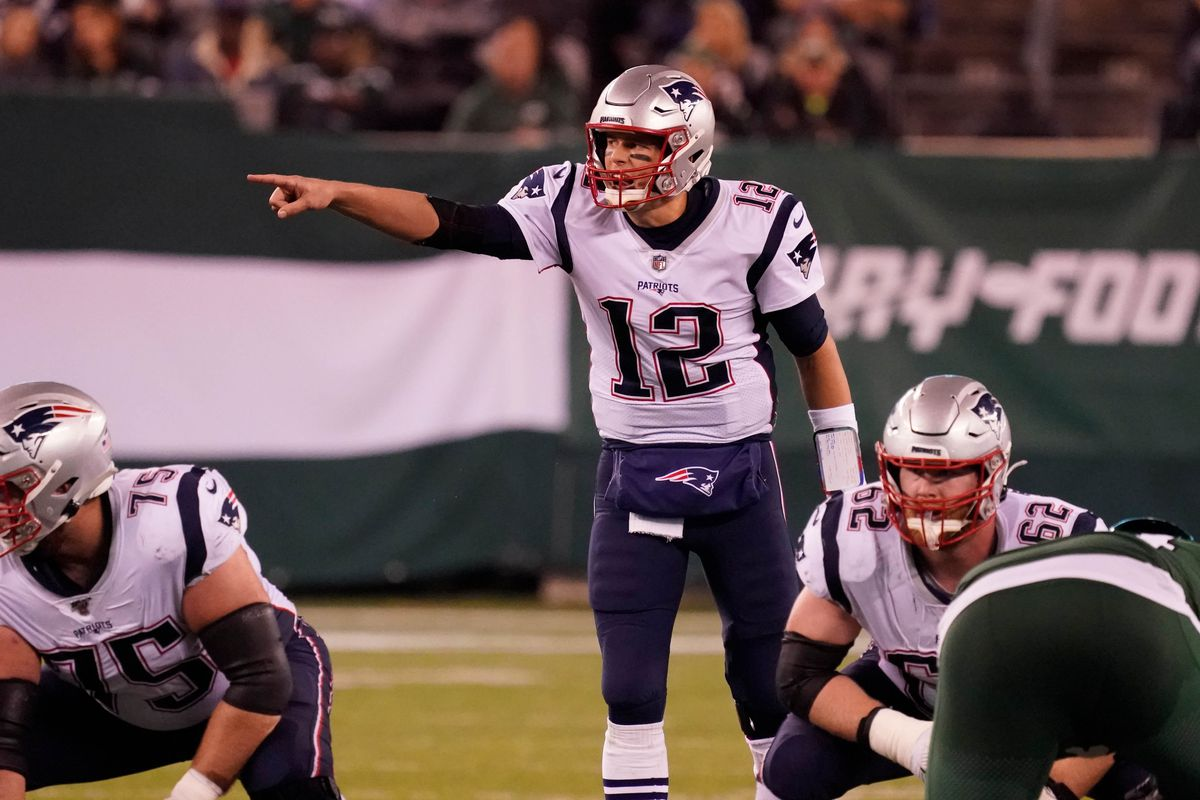 New England Patriots quarterback Tom Brady at the line of scrimmage calling out a play in the second half at MetLife Stadium.