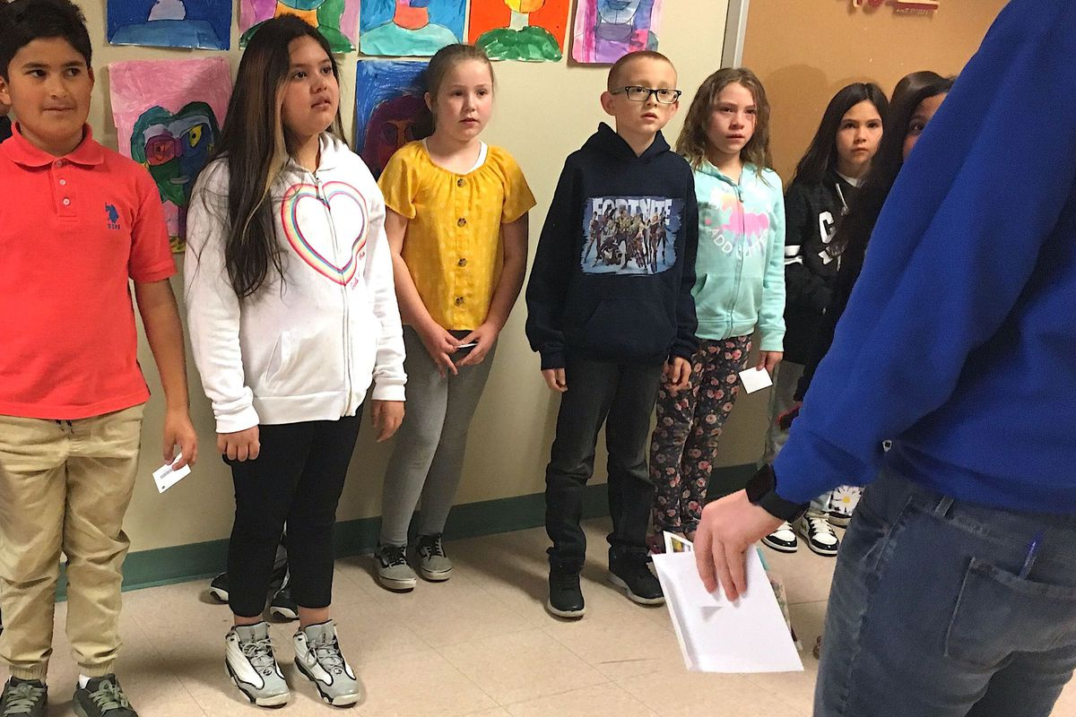 Fourth-grade students wait in the hallway at Stevens Elementary School in Wheat Ridge.