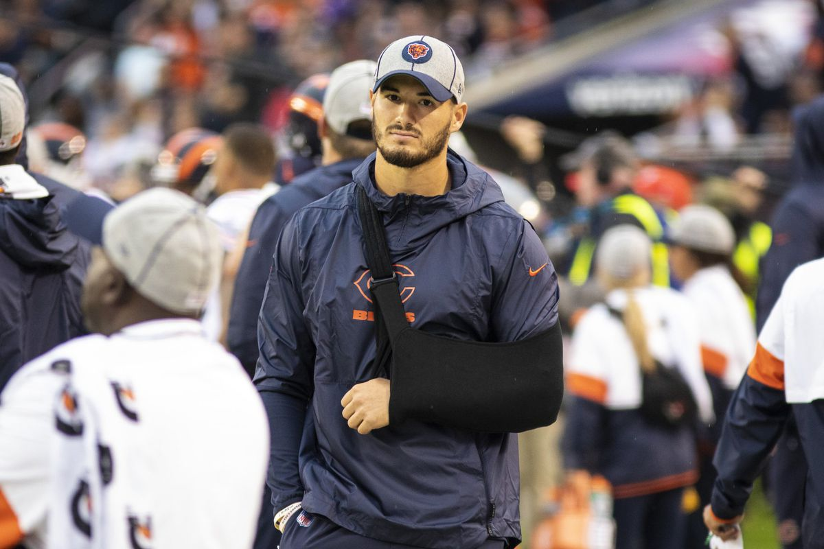 Mitch Trubisky wearing a sling on the sideline after leaving the Bears-Vikings game with a shoulder injury.
