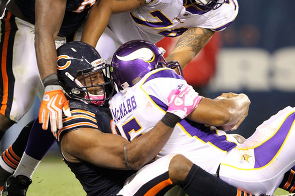 CHICAGO, IL - OCTOBER 16:  Amobi Okoye #91 of the Chicago Bears sacks quarterback Donovan McNabb #5 of the Minnesota Vikings at Soldier Field on October 16, 2011 in Chicago, Illinois.  (Photo by Jamie Squire/Getty Images)