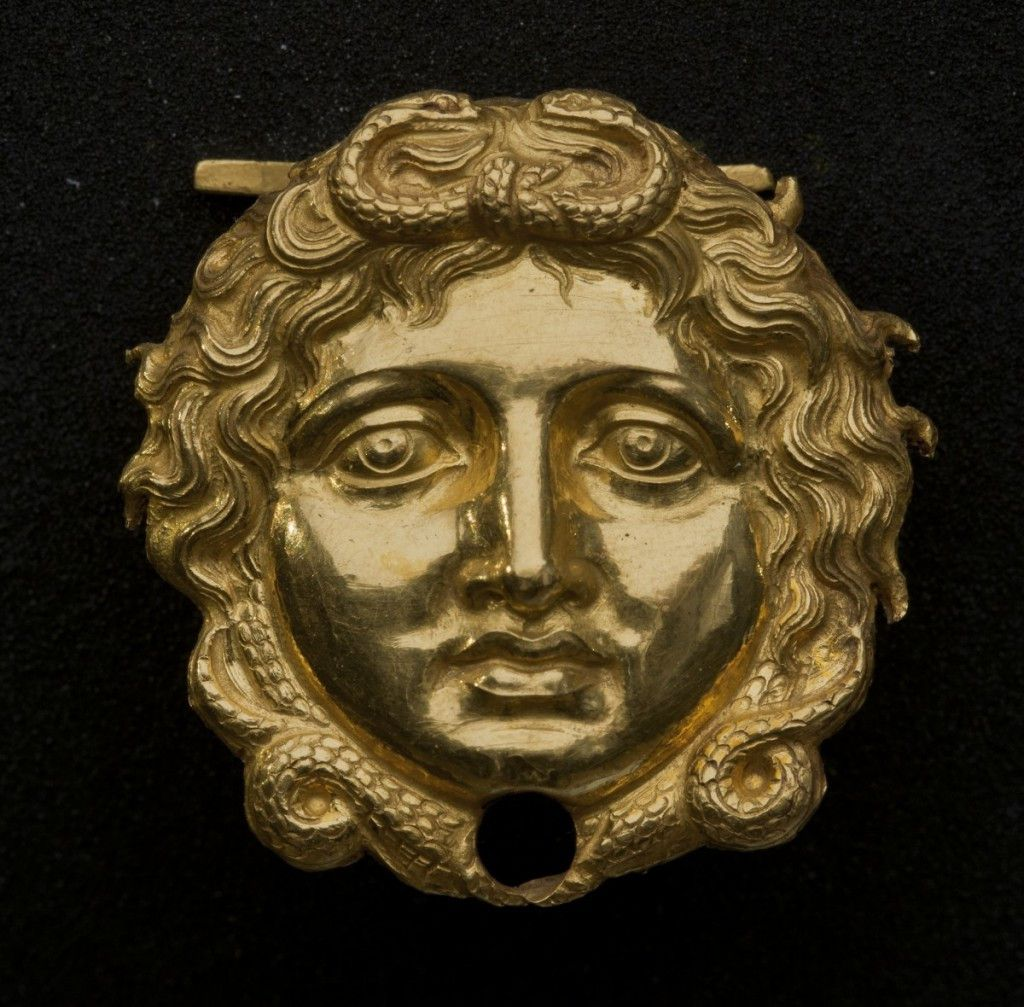 """Gold gorgon head in the Field Museum exhibition, """"The Greeks: From Agamemnon to Alexander the Great."""" (Courtesy of Museum of the Royal Tombs of Aigai, Vergina)"""