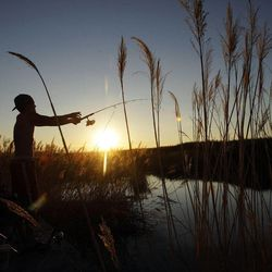 Brandon Russell fishes in fresh water near the Great Salt Lake in Salt Lake County  July 7, 2012.