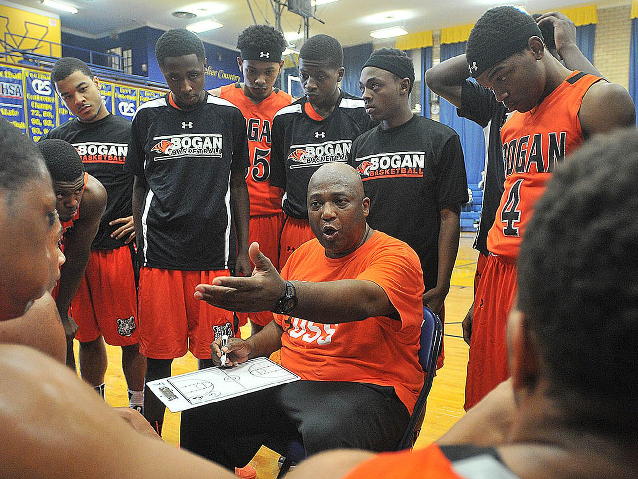 Bogan coach Arthur Goodwin talks to his players during a time out.