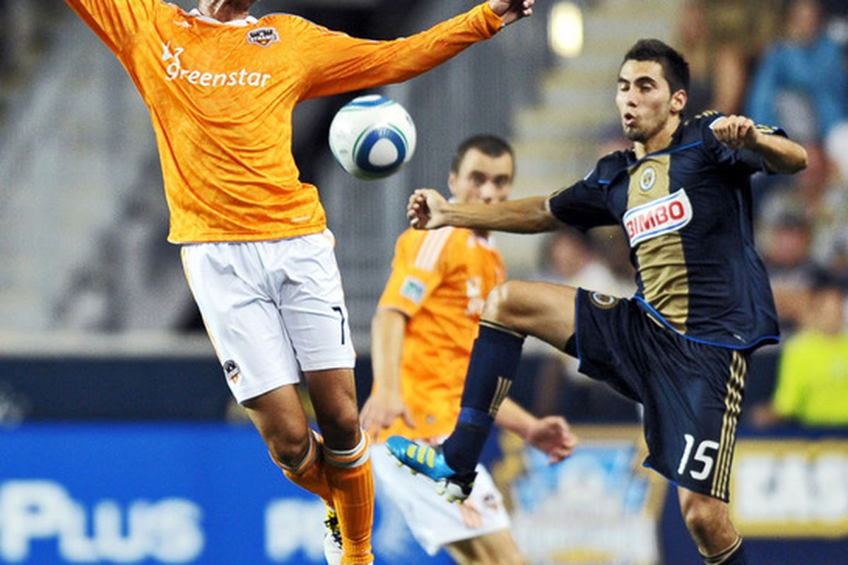 CHESTER, PA- AUGUST 06: Colin Clark #7 of the Houston Dynamo and Gabriel Farfan #15 of the Philadelphia Union jump for the ball at PPL Park on August 6, 2011 in Chester, Pennsylvania. The game ended 1-1. (Photo by Drew Hallowell/Getty Images)