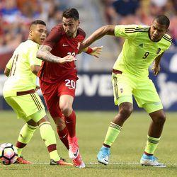 United States defender Geoff Cameron (20) kicks the ball between Venezuela forward Darwin Machis (11) and Venezuela forward Jose Salomon Rondon (9) during a soccer game at Rio Tinto Stadium in Sandy on Saturday, June 3, 2017. They tied 1-1.