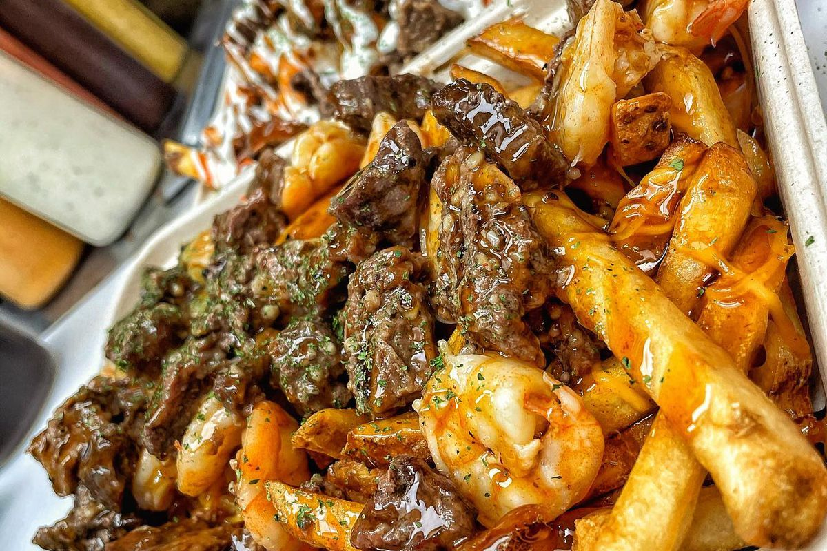 Loaded fries topped with steak and shrimp from Mr. Fries Man