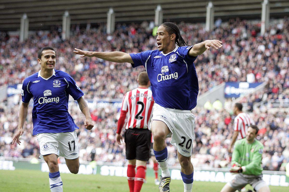 Everton's Steven Pienaar (R) celebrates