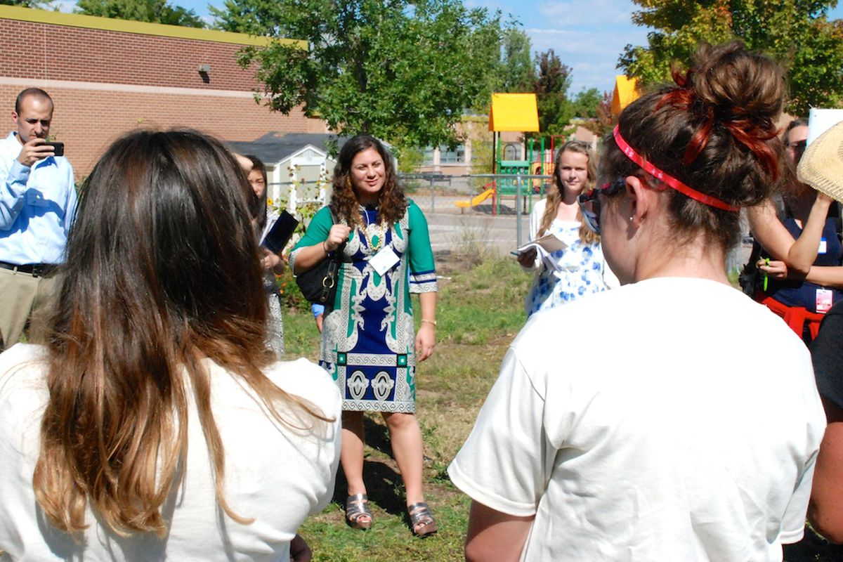 Andrea Suarez Falken, center, listens to students from the Denver Green School share some sustainability lessons Tuesday. Suarez Falken is the director of the U.S. Department of Education Green Ribbon Schools. Her team is on a statewide tour of schools that are both high performing and eco-friendly this week.