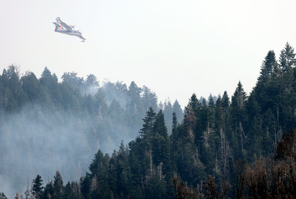 A water tanker begins a run to drop water as crews continue fighting the Parley's Canyon Fire near Park City on Sunday, Aug. 15, 2021.