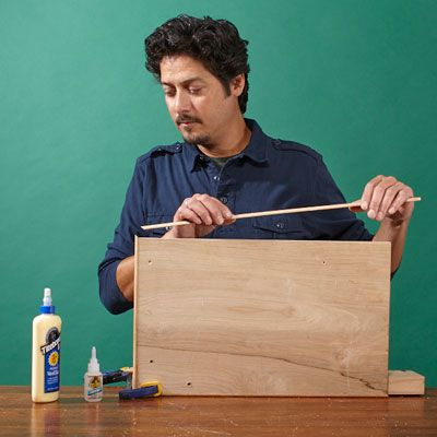Man Edges Plywood Deck To Build Log Holder