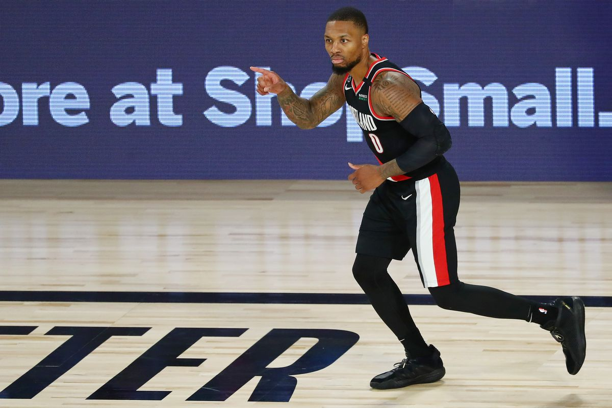 Damian Lillard of the Portland Trail Blazers reacts after making a three point basket during the second half against the Dallas Mavericks at The Field House at ESPN Wide World Of Sports Complex on August 11, 2020 in Lake Buena Vista, Florida.
