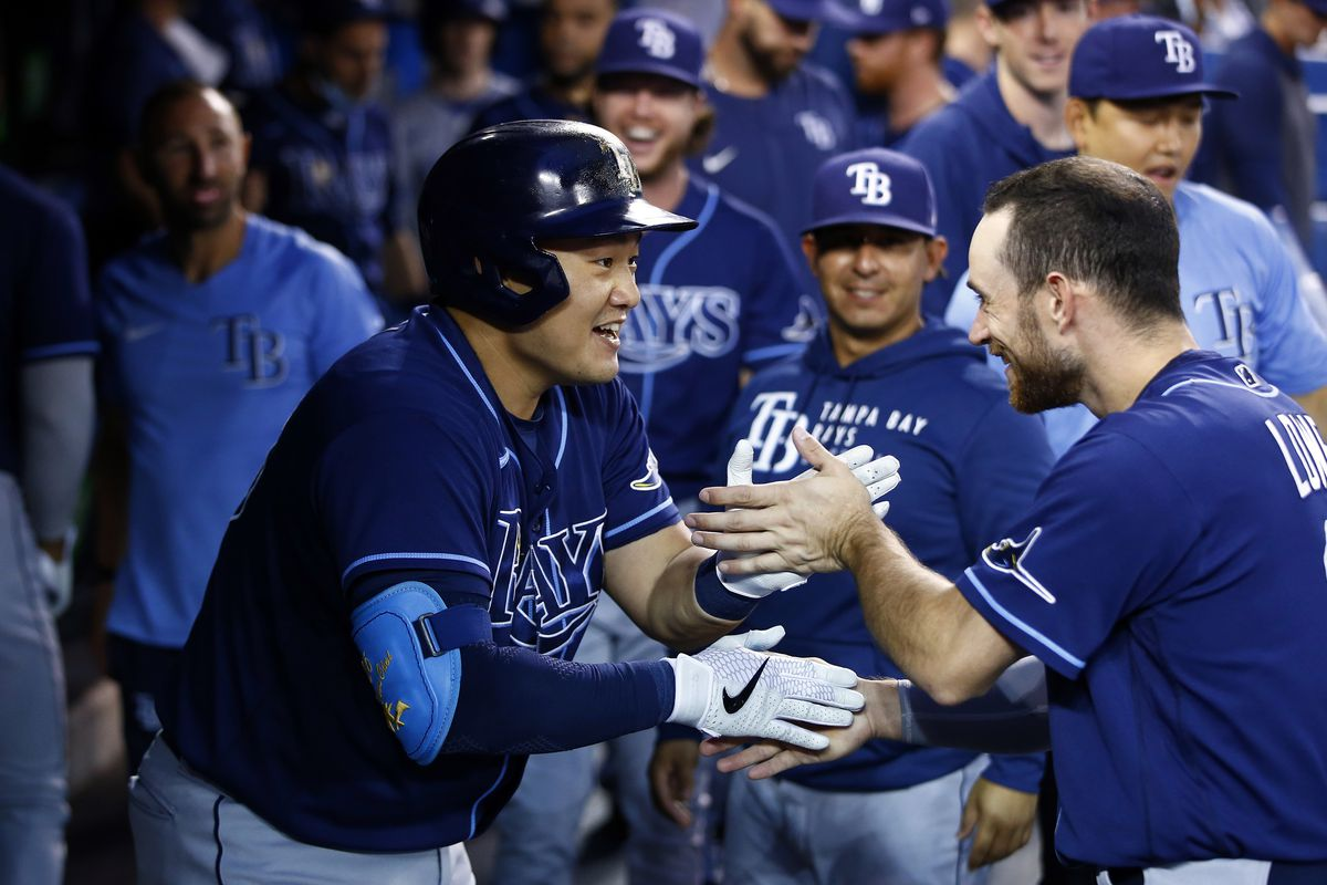 Ji-Man Choi of the Tampa Bay Rays celebrates with Brandon Lowe after hitting a solo home run in the second inning during a MLB game against the Toronto Blue Jays at Rogers Centre on September 14, 2021 in Toronto, Ontario, Canada.