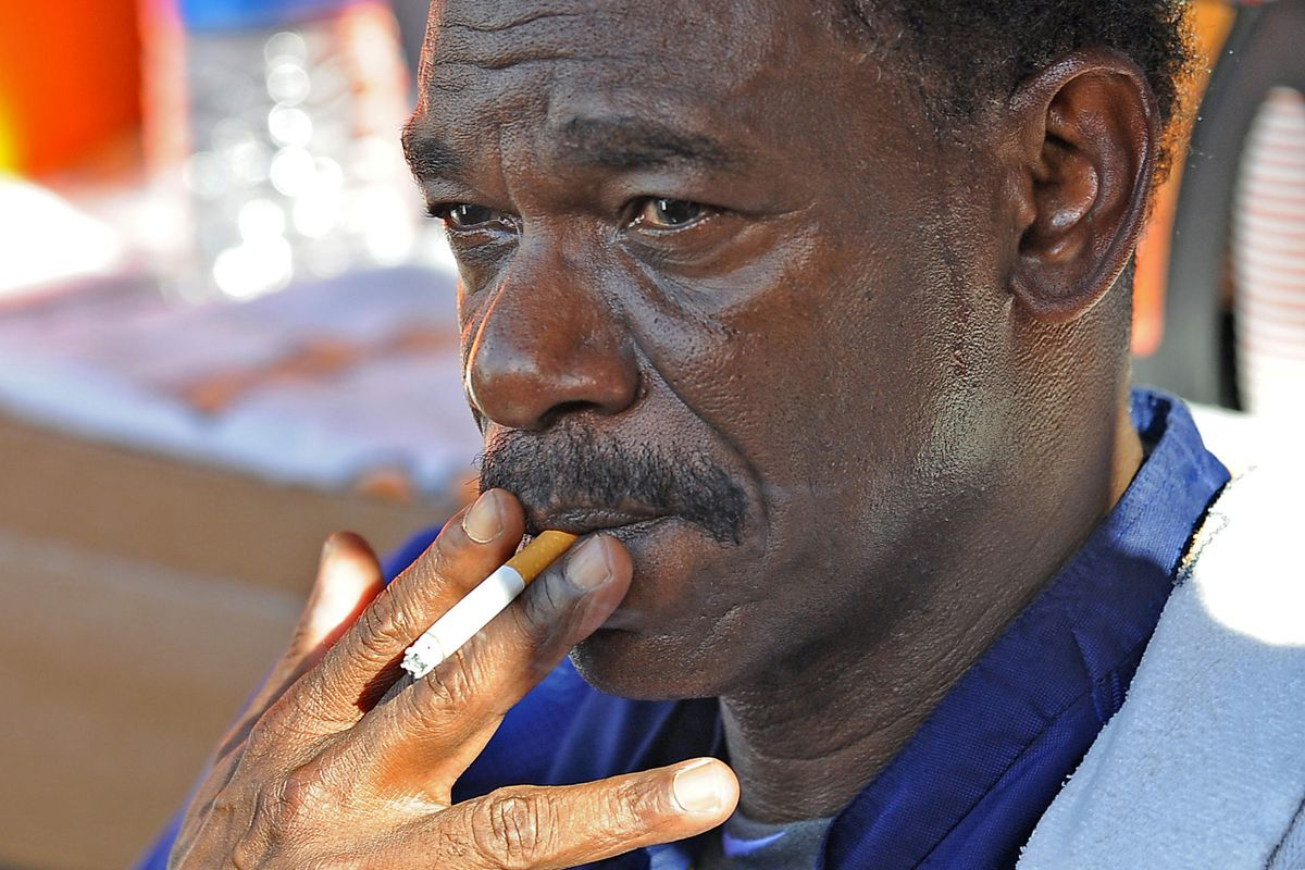 July 20, 2012; Anaheim, CA, USA;  Texas Rangers manager Ron Washington (38) smokes in the dugout during batting practice before the game against the Los Angeles Angels at Angel Stadium. Mandatory Credit: Jayne Kamin-Oncea-US PRESSWIRE