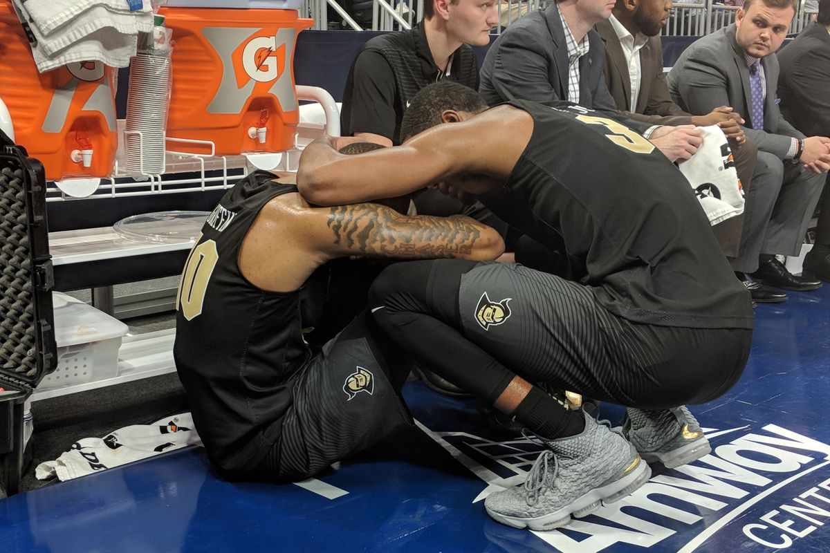Senior A.J. Davis consoles junior Dayon Griffin during the closing moments of UCF's AAC Conference Tournament loss to Houston on Friday night. (Photo: Brian Murphy)