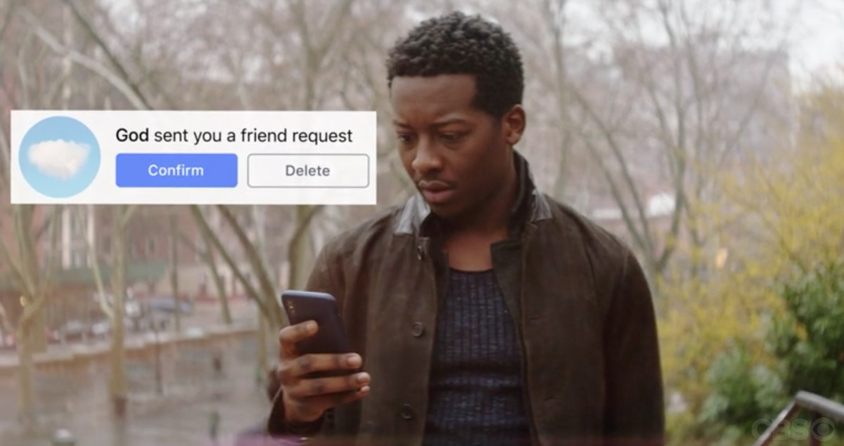 """Still of Brandon Micheal Hall looking at his phone and seeing the notification """"God sent you a friend request"""""""