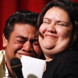 Siaosi Heimuli, left, receives a hug from his teacher, Keri Gaybill, right, at a ceremony honoring Heimuli as Granite School District's Absolutely Incredible Kid at Granite Park Junior High in Salt Lake City on Monday, May 23, 2016.