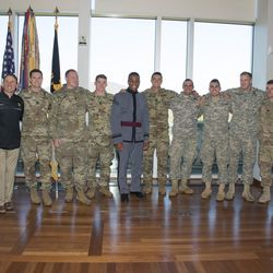 """Standing center in uniform, West Point cadet Raaqim Rispress, a returned Mormon missionary, was recently honored with the Lt. Gen Harold """"Hal"""" G. Moore Warrior Athlete of Excellence Award."""
