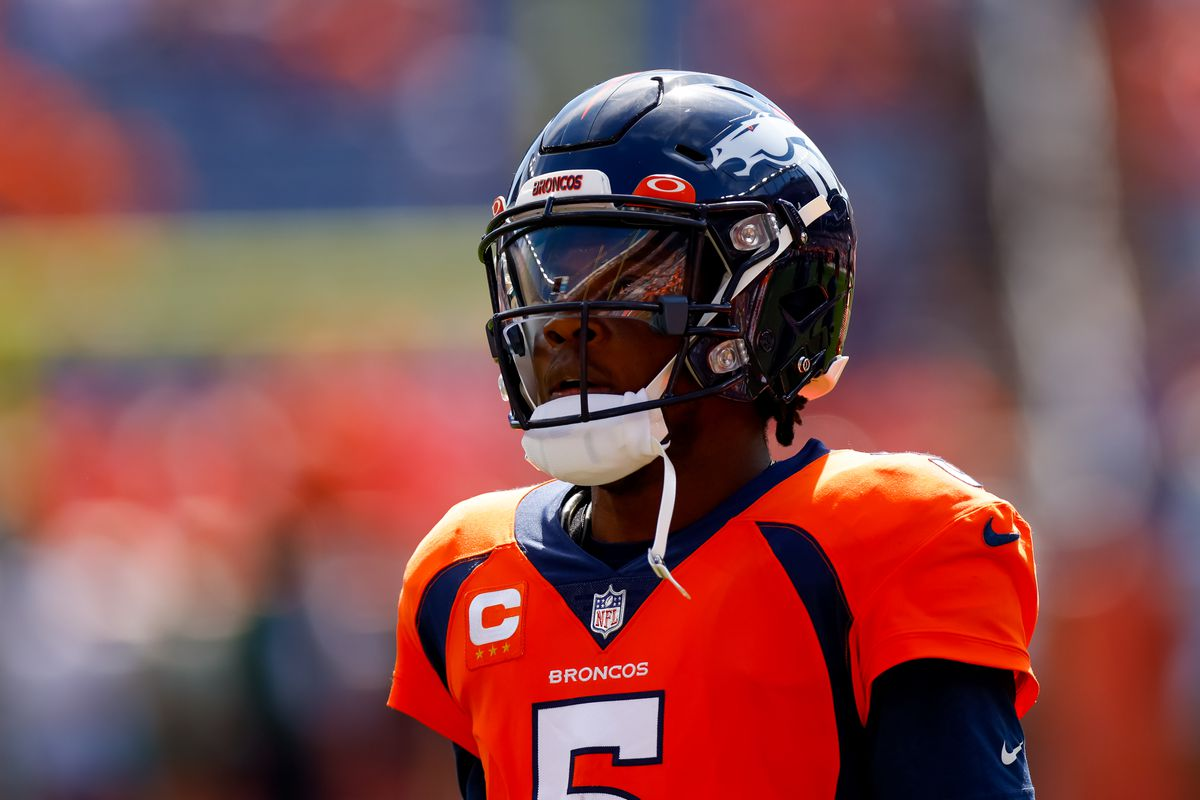 Quarterback Teddy Bridgewater #5 of the Denver Broncos looks on from the field while warming up against the New York Jets at Empower Field at Mile High on September 26, 2021 in Denver, Colorado.