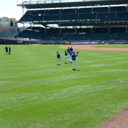 11:50 a.m. Cubs players loosening up on the field -