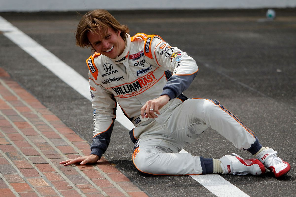 The irrepressable Dan Wheldon celebrates his Indianapolis 500 win in 2011. (Photo by Jonathan Ferrey/Getty Images)