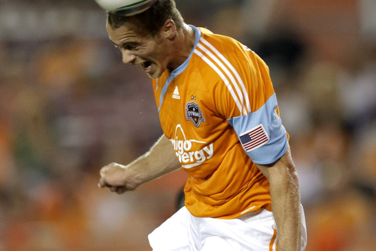 HOUSTON - SEPTEMBER 05:  Cam Weaver #15 of the Houston Dynamo gets his head on a shot in the  box but can't put in on goal against the San Jose Earthquakes at Robertson Stadium  on September 5 2010 in Houston Texas.  (Photo by Bob Levey/Getty Images)