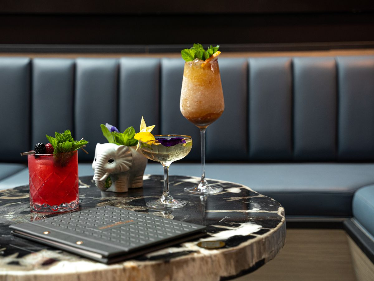 An artful arrangement of cocktails on a bar table.