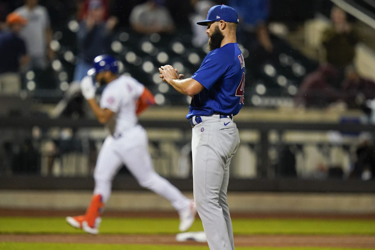 Cubs starting pitcher Jake Arrieta stands on the mound as the Mets' Dominic Smith runs the bases after hitting a home run during the fifth inning.