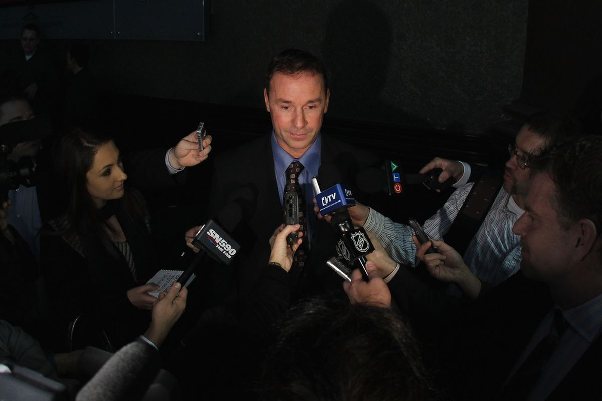 TORONTO, ON - NOVEMBER 14:  2011 Hall of Fame inductee Joe Nieuwendyk is interviewed by the media during a photo opportunity at the Hockey Hall Of Fame on November 14, 2011 in Toronto, Ontario, Canada.  (Photo by Bruce Bennett/Getty Images)