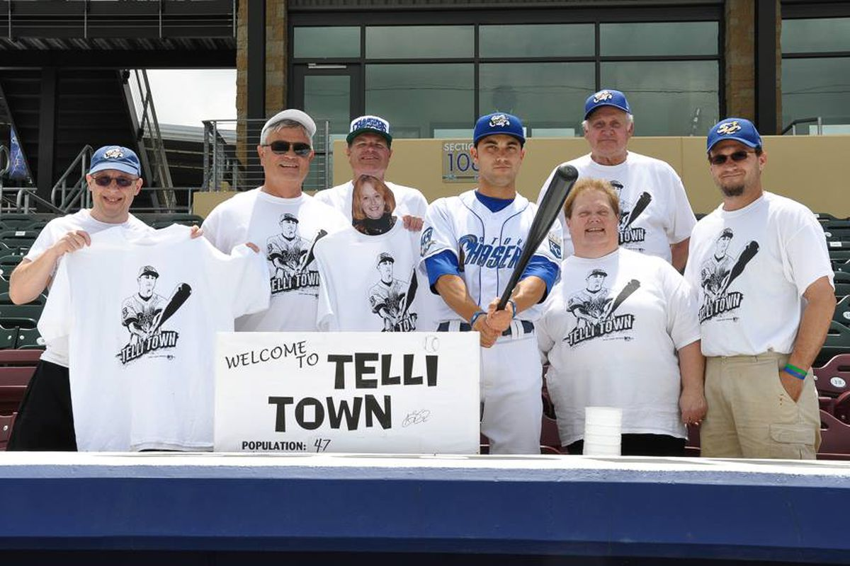 Seratelli poses with residents of Telli Town in 2013 as a member of the Omaha Storm Chasers