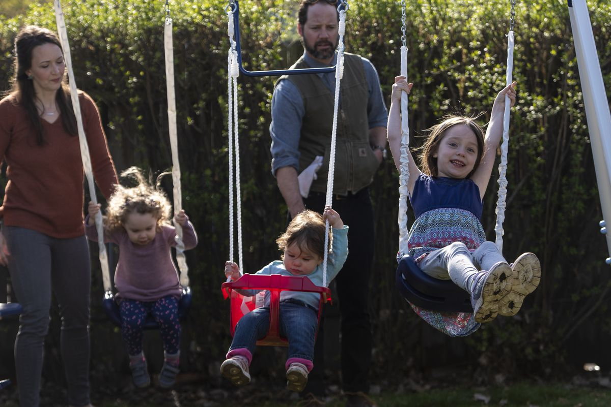 The Anderes family enjoys time together swining on the swing set, Thursday, April 30, 2020.