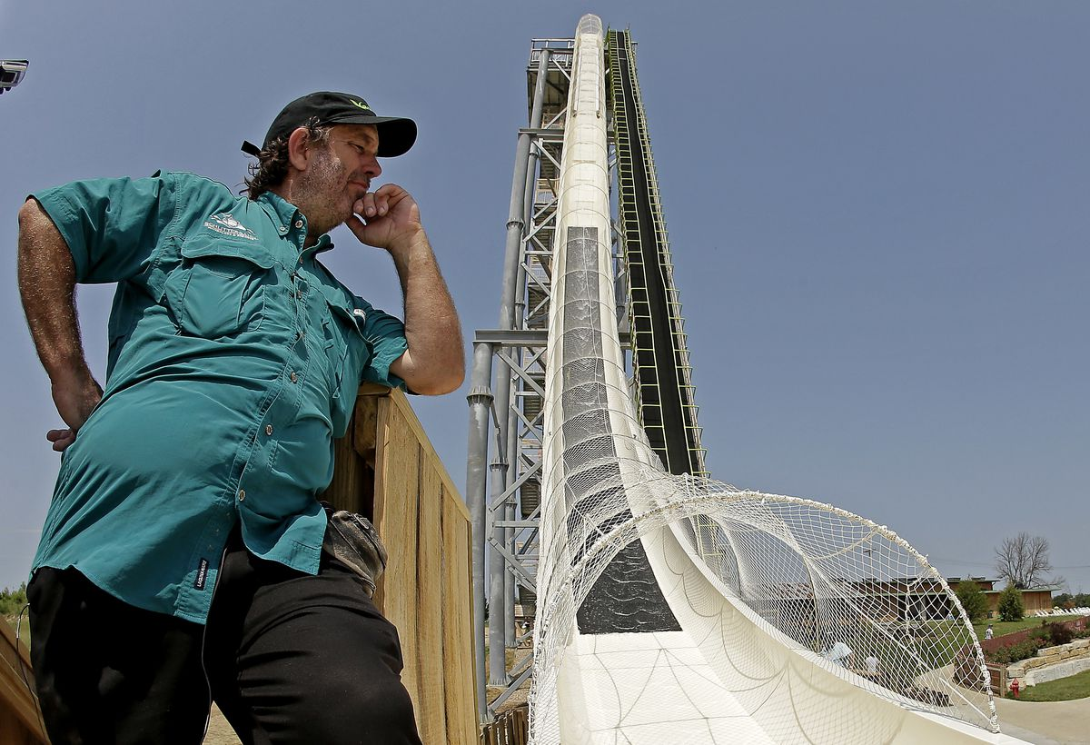 """FILE – In this July 9, 2014, file photo, ride designer Jeffery Henry looks over his creation, the world's tallest waterslide called """"Verruckt"""" at Schlitterbahn Waterpark in Kansas City, Kan. The Kansas City Star reports that Schlitterbahn Waterparks and R"""