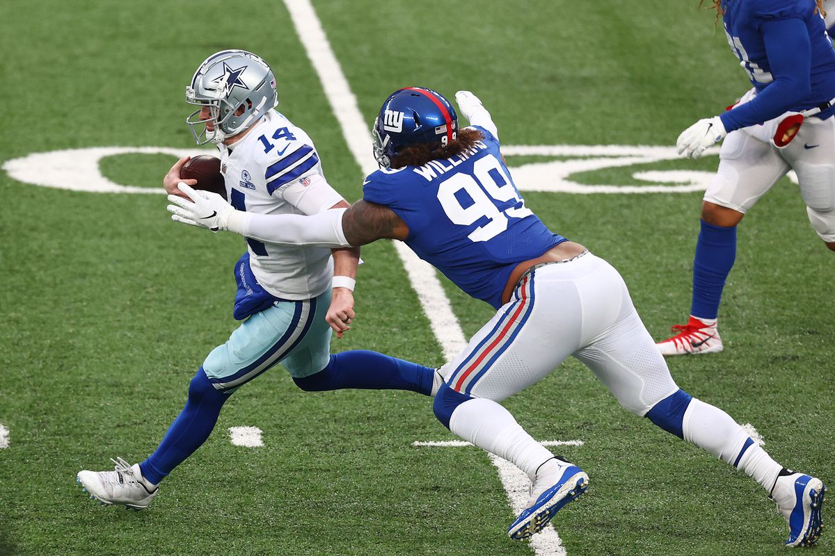 Andy Dalton #14 of the Dallas Cowboys is sacked by Leonard Williams #99 of the New York Giants during the first quarter at MetLife Stadium on January 03, 2021 in East Rutherford, New Jersey.