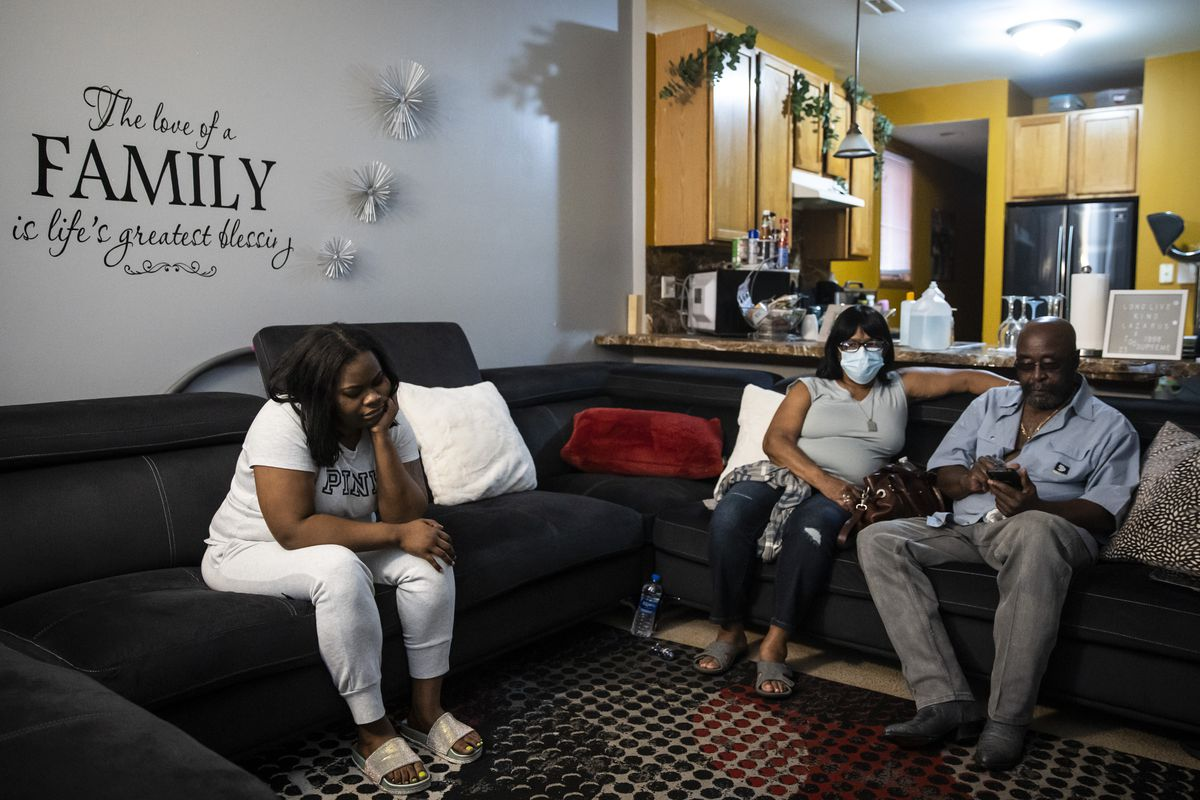 Brittany Benson, 32, sits with family members Thursday afternoon in her mother's living room in Lawndale, hours after her 15-year-old son Damarion Benson was shot to death at the corner of Douglas Boulevard and Christiana Avenue on the West Side.
