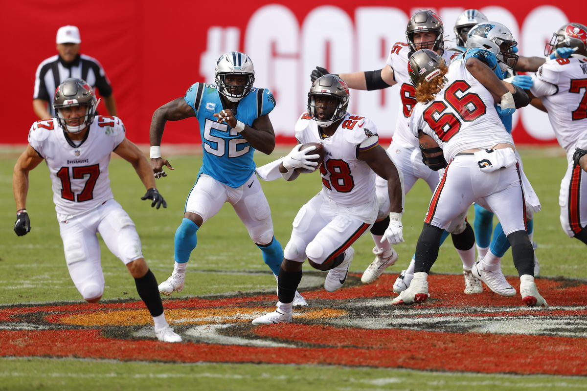 Leonard Fournette of the Tampa Bay Buccaneers runs with the ball during the second half against the Carolina Panthers at Raymond James Stadium on September 20, 2020 in Tampa, Florida.